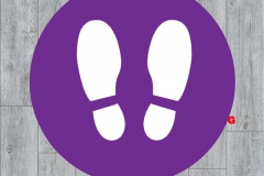 Footprint-on-purple-wood